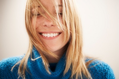 Young blonde woman smiling after getting a cosmetic dentistry procedure, Century Dental Hillsboro, OR